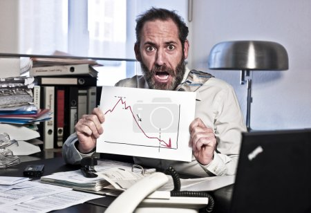 Photo for Businessman sees the bankrupcy and gets panic {shot on PhaseOne P45} - Royalty Free Image