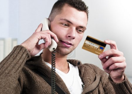Businessman having conversation on telephone