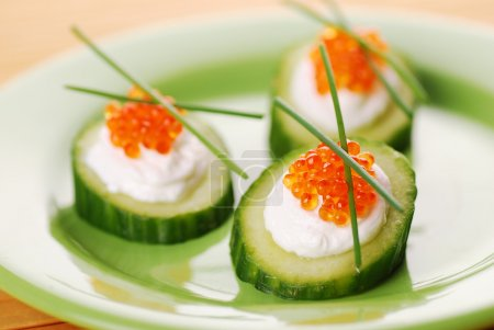Photo for Appetizers with red caviar and a cucumbe - Royalty Free Image