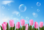 Blue background with realistic bubbles and flowers