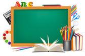 Green desk with school supplies