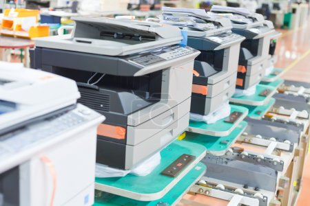 Several assembled copiers on factory