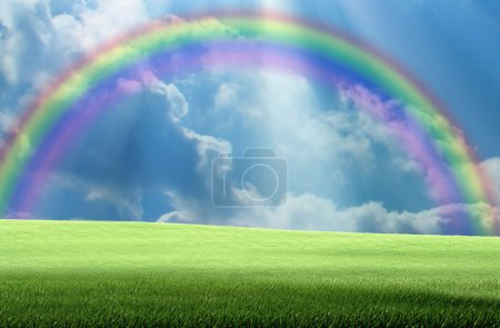 Photo for Grassland and sky with sunlight and rainbow in the background - Royalty Free Image