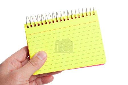 Photo pour Main tenant un bloc-note avec fond blanc - image libre de droit