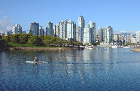 Vancouver BC waterfront False creek bay south side & sailboats.