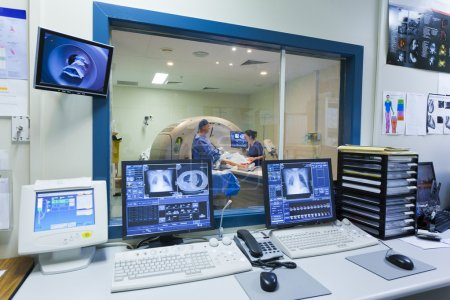 Photo for MRI machine and screens with doctor and nurse - Royalty Free Image