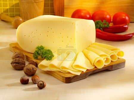 Arrangement with appetizing cheese on the kitchen table.