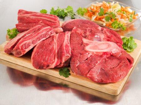 Raw beef shank on a cutting board