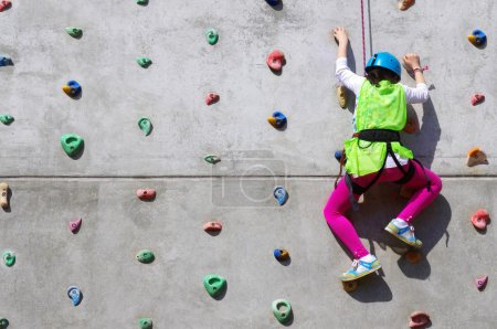 Youngster's effort in climbing a wall to reach the...