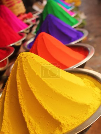 Colorful piles of powdered dyes on display
