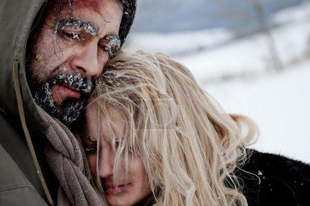 Photo for Close-up of freezing homeless couple struggle and hug - Royalty Free Image