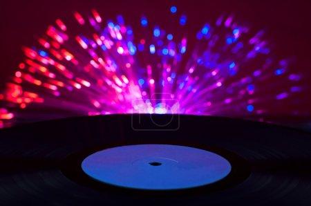 LP vinyl record and disco lights