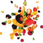 Fresh fruit pieces mix, isolated on white backgrou...