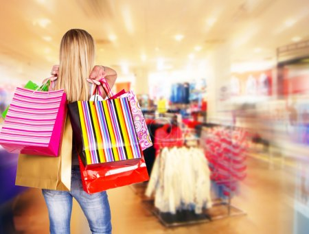 Photo for Blond woman with shopping bags in shopping center - Royalty Free Image