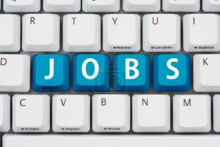 Foto de Un teclado de computadora con teclas azules trabajos de ortografía, Solicitar trabajos en Internet - Imagen libre de derechos