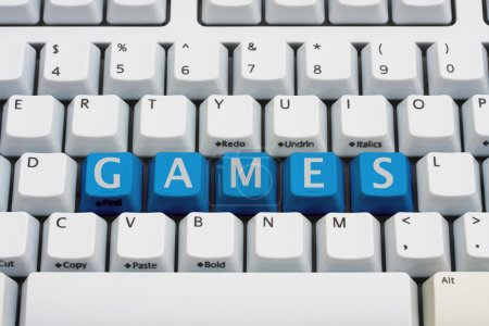 Photo for A computer keyboard with blue keys spelling games, Playing computer games - Royalty Free Image