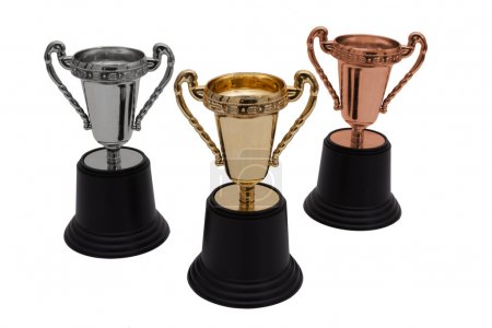 Photo for Three trophies, gold, silver and bronze isolated on white, First, Second and Third Place - Royalty Free Image