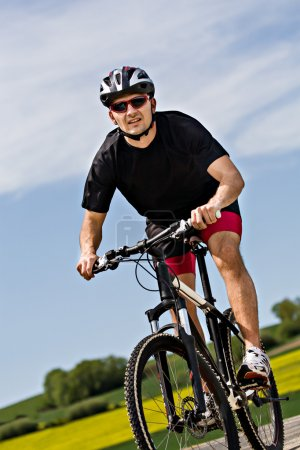 Photo for Young man cycling Cross-country (XC) - Royalty Free Image