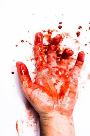 Foto de Una mano de hemorragia en la superficie blanca - Imagen libre de derechos