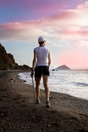 Photo for A woman hiking at the sea - Royalty Free Image