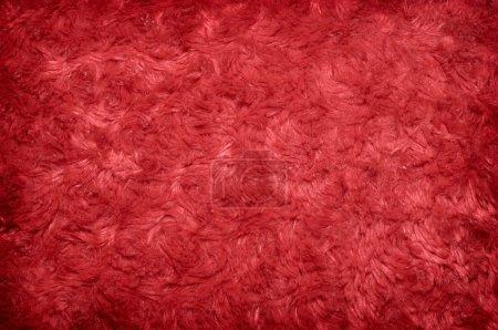 Photo pour Fond rouge texture polyester poilue - image libre de droit