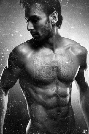 Sexy fine art portrait of a very muscular shirtless male model looking
