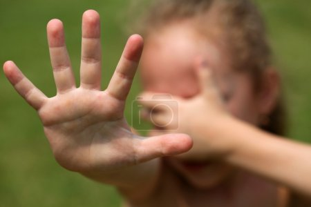 Child refuses, and is covered hands