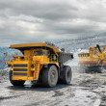 Loading of iron ore on very big dump-body truck...