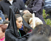 GRANADA, SPAIN - APRIL 6: Female participant in Easter Procession on April 6, 2012 in Granada, Spain. The woman carries the traditional head coverage called mantilla