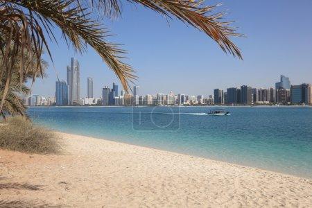 Beach and the skyline of Abu Dhabi, United Arab Emirates