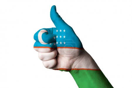 Hand with thumb up gesture in colored uzbekistan n...