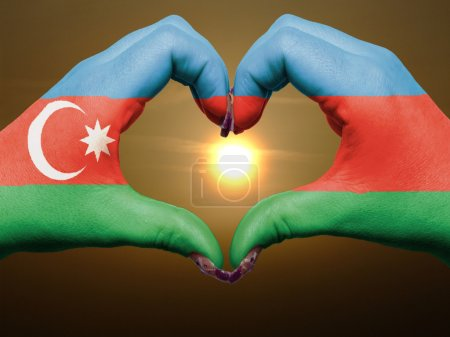 Heart and love gesture by hands colored in azerbaijan flag durin