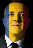 Tvář vážný podnikatel nebo politik v barvách r