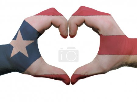 Heart and love gesture in puerto rico flag colors by hands isola