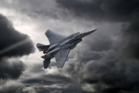 Photo for F-15 Eagle flying through the storm - Royalty Free Image