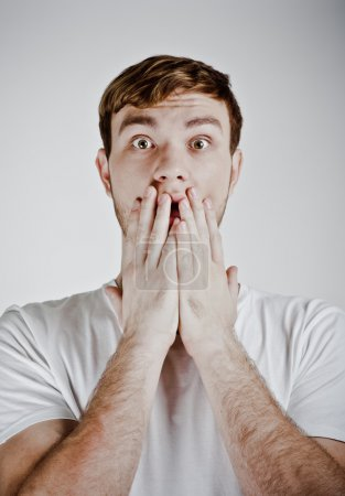 Scared adult man with hands