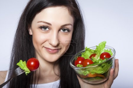 Photo for Pretty girl eating salad - Royalty Free Image