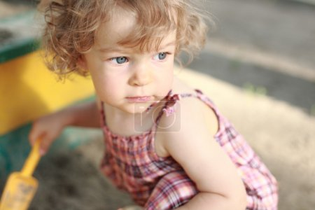 Photo for Child plays in sandpit - shallow depth of field - Royalty Free Image
