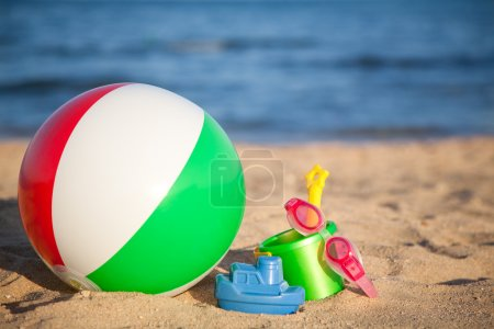 Children`s toys at the beach