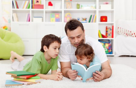 Father reading stories to his boys