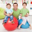 Fun with gymnastic balls - young boys playing with...