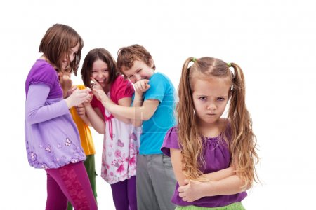 Photo for Group of kids bullying and mocking their colleague - an upset little girl - Royalty Free Image