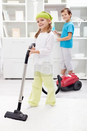 Kids cleaning the room