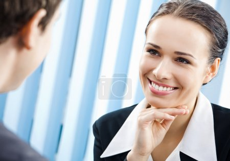 Happy businesspeople, or business woman and client