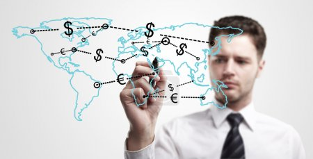 Young business man drawing a global network with Dollar Signs on world map.