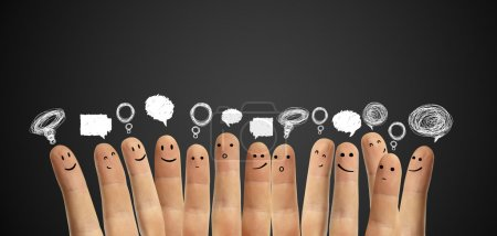 Photo for Happy group of finger smileys with social chat sign and speech bubbles. Fingers representing a social network. - Royalty Free Image
