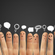 Happy group of finger smileys with social chat sig...