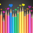 Group of coloured smiling pencils with love heart speech bubbles and social chat sign. Set of coloured pencils representing a social network
