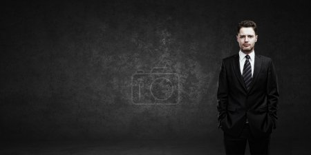 Portrait of a young businessman with place for your text.