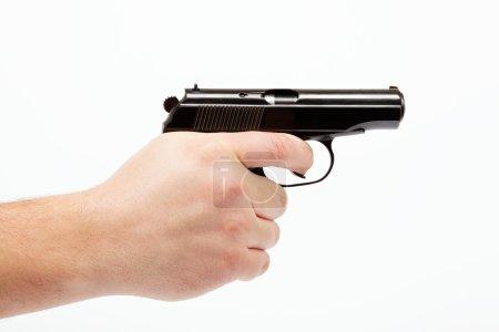 Gun in hand on a white background.
